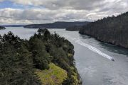 A boat speeds through Deception Pass on a Whidbey Island private tour from Seattle