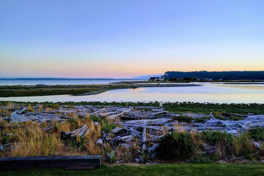 Colorful evening skies over the water on a Whidbey Island day tour from Seattle